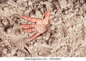bigstock-Hand-on-a-beach-sinking-or-dro-30529991