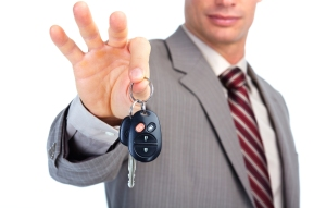 bigstock-Hand-with-a-car-key--30094400
